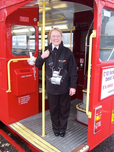 Photo of a conductor on our Routemaster bus's open platform