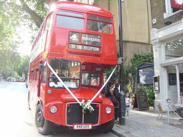 The Routemaster parked outside a church.