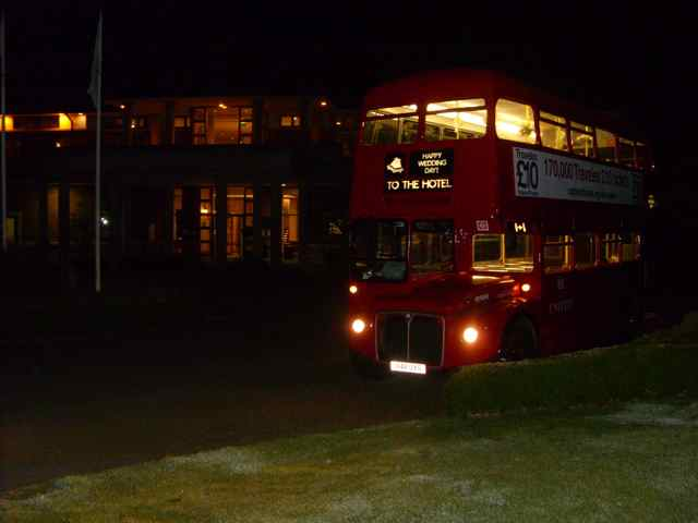 The Routemaster by a golf course.